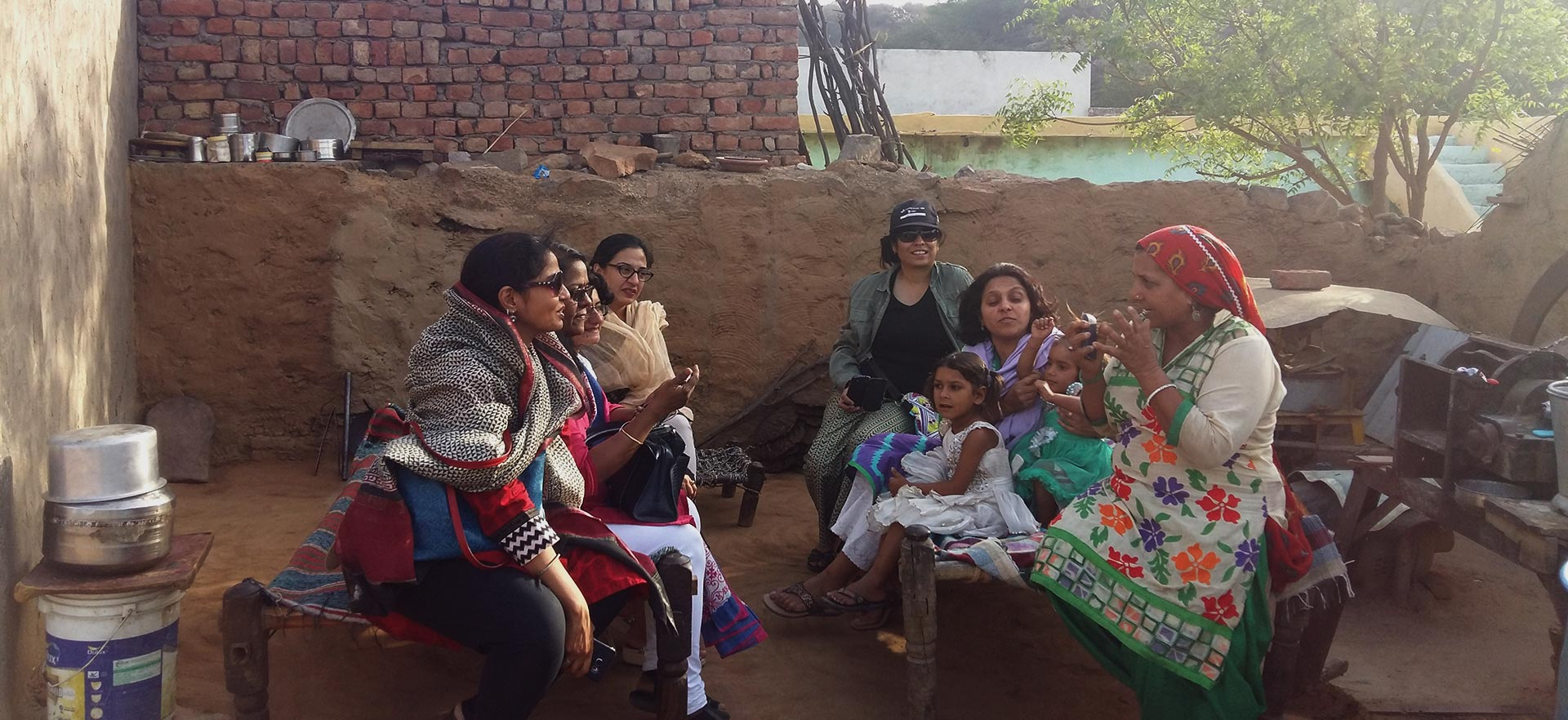 Engaging with village women at the Wholistic Retreat